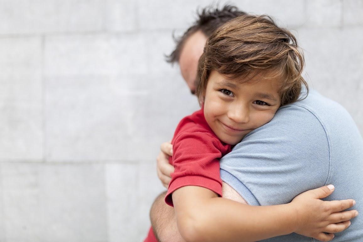 little boy hugging his dad